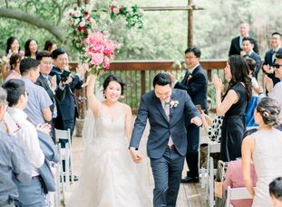 A remote amphitheater among towering oak trees set the stage for Jueun and Jonathan's rustic garden party, where DIY wood accents and homemade favors,