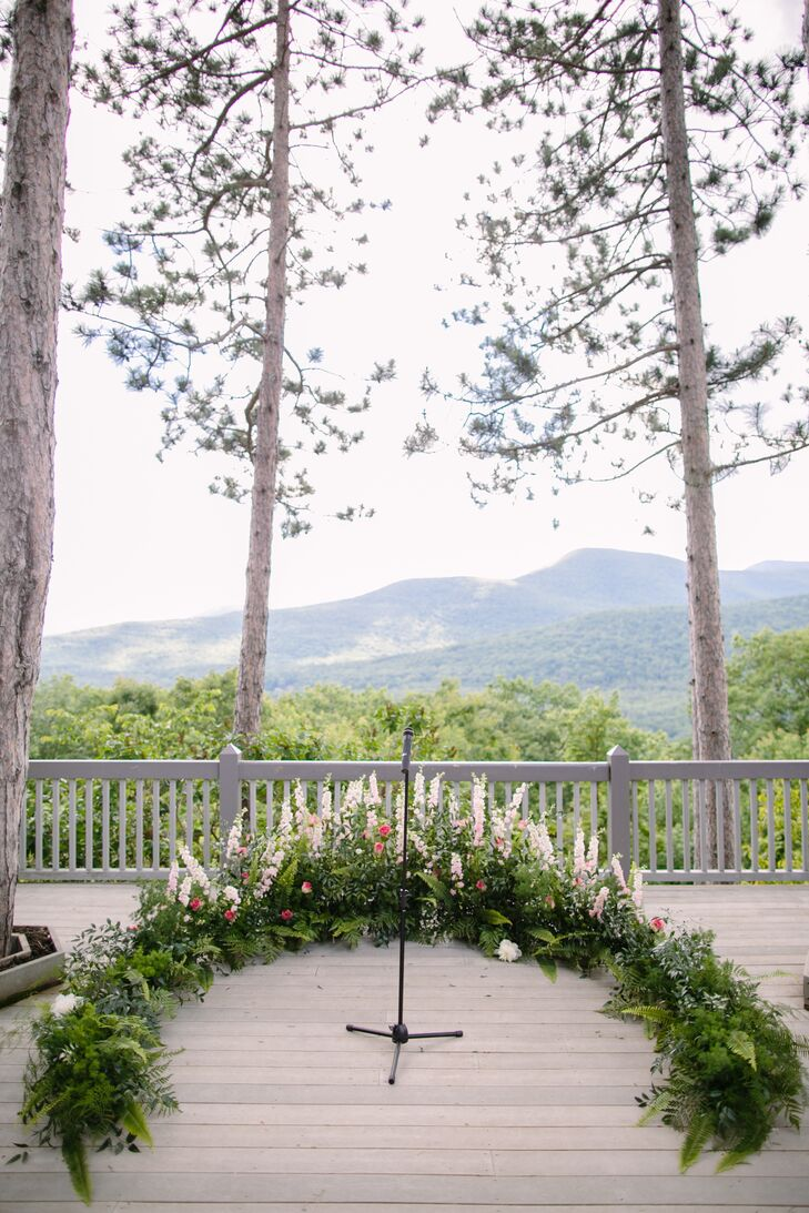 The florists at Viridescent Floral Design brought the beauty of the mountains alive for the ceremony, creating a lush semicircular garland rich in textured greens and fresh wildflowers to frame Julia and Lucas as they exchanged vows.