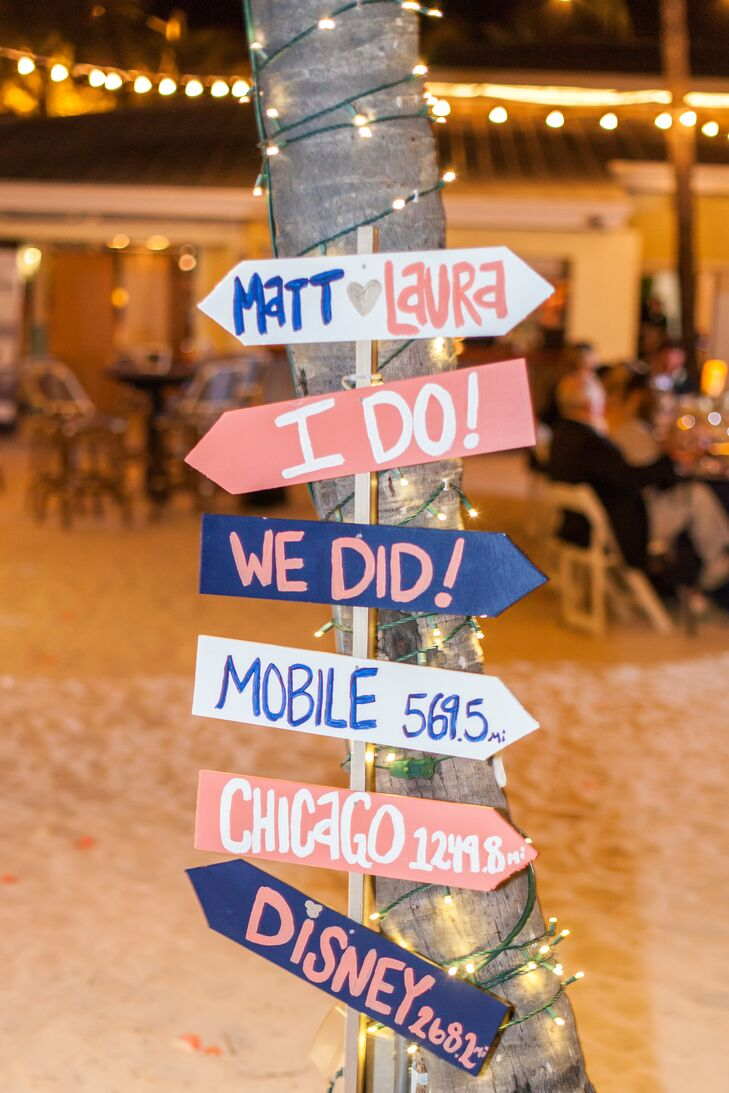Laura and Matt included a few other locations in their wedding. DIY signs toward Alabama  (where Laura's family lives) and  Disney World (where they got engaged) accented the reception space in the couple's wedding colors. After the ceremony, Laura and her bridesmaids even took a picture around the signs.