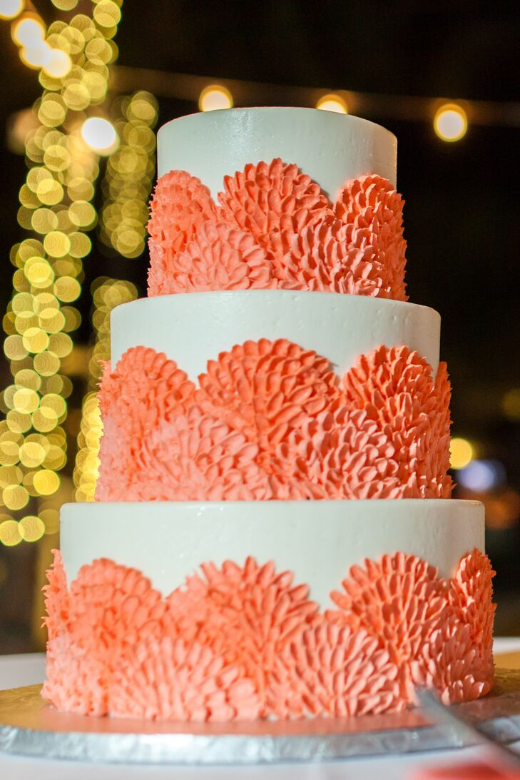 Laura and Matt treated their guests to key lime pie and a s'mores station before bringing out the wedding cake. Key West Cakes baked a three-tier confection covered with fun fondant designs in a bright coral hue.