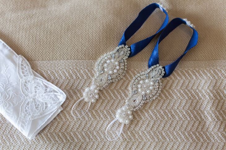 Instead of traditional wedding shoes, Laura added a different style to her beach wedding-day look. She wore a pair of custom navy barefoot sandals by Stella Designs with pearls and intricate beading. Her bridesmaids even wore pearl jewelry that matched the accent.