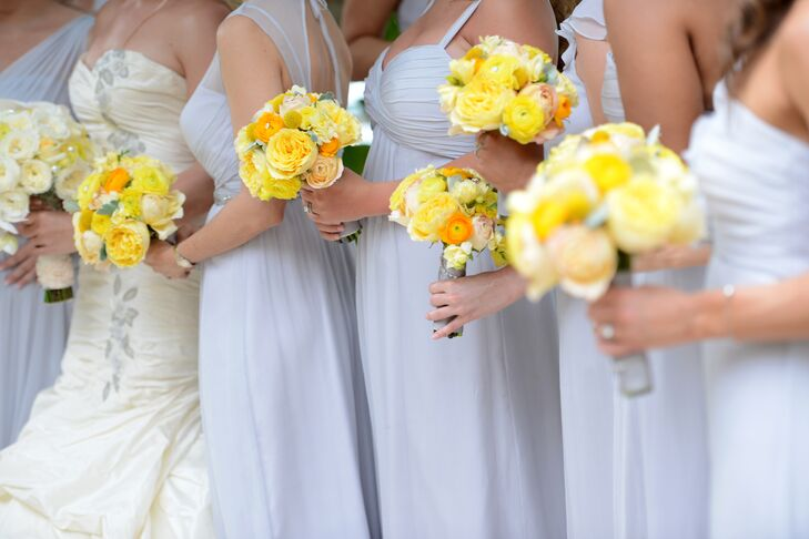 Bridesmaids wore silvery purple Amsale bridesmaid dresses that were floor-length.