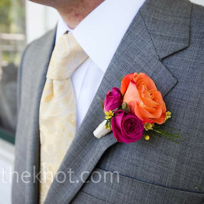 In keeping with the color scheme, a cluster of orange and pink roses and yellow wax flowers decorated Christian's lapel and worked well with his soft yellow tie.