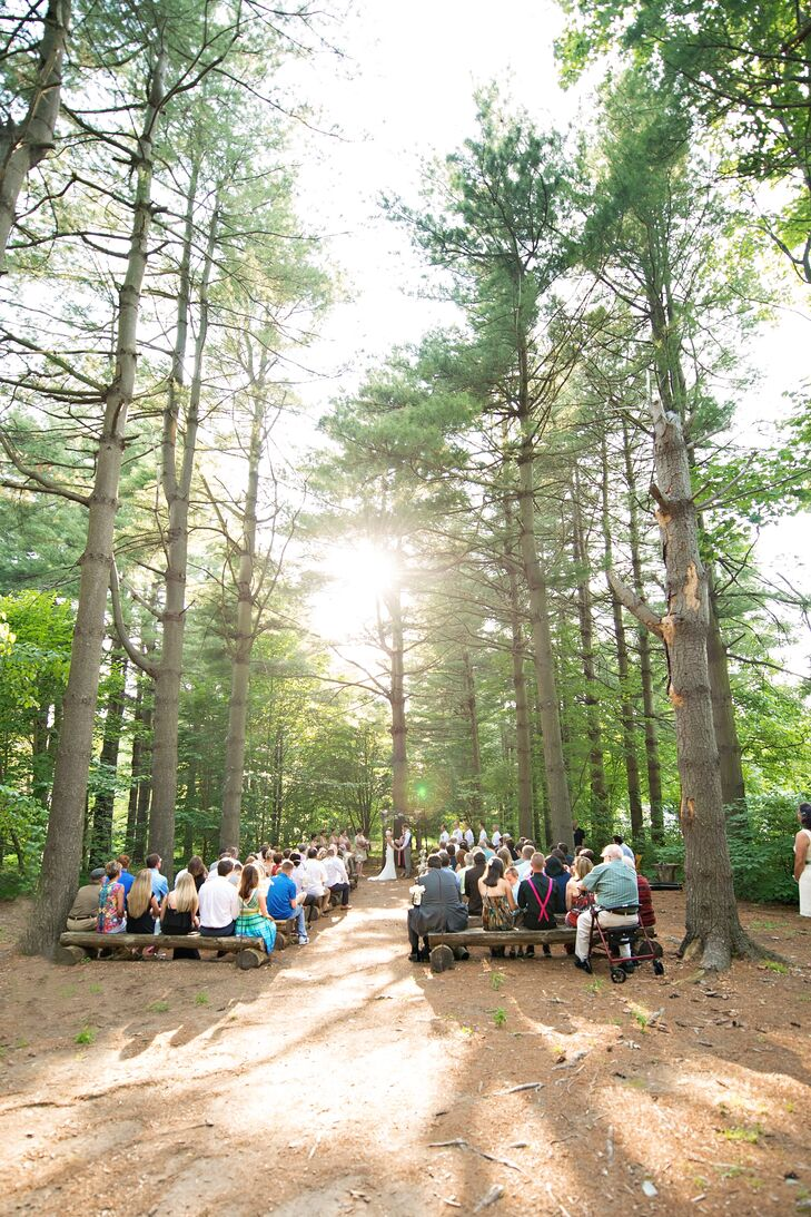 The summertime ceremony took place in the forest at Thorpewood. Guests sat on benches made out of wood logs.