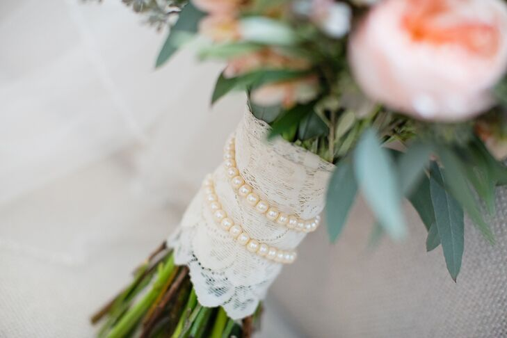 "The stems of Mary's bouquet were wrapped with lace and pearls that had belonged to her grandmother. ""It was a special way to honor her and have her close to my heart on my wedding day,"" she says."