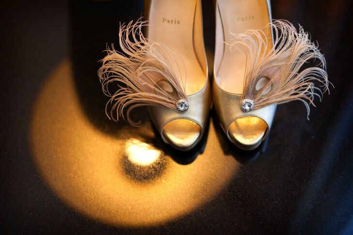 Barbara wore gold Christian Louboutin peep-toes adorned with feather shoe clips.
