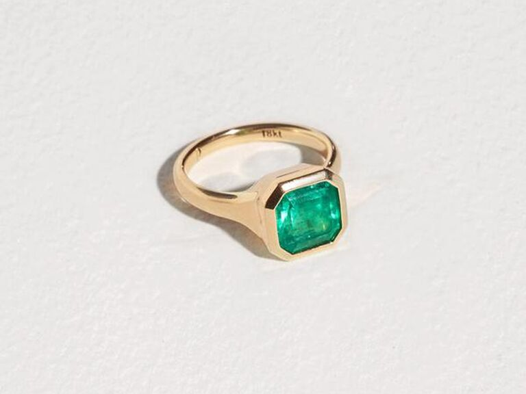 Bezel-set emerald engagement ring