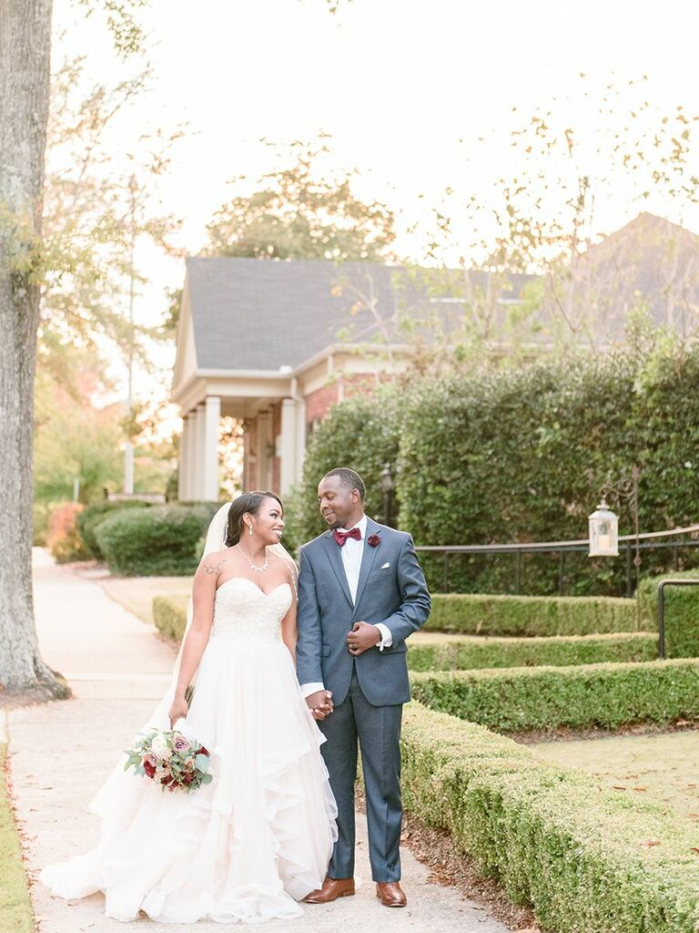 bride and groom walking outside holding hands Alabama