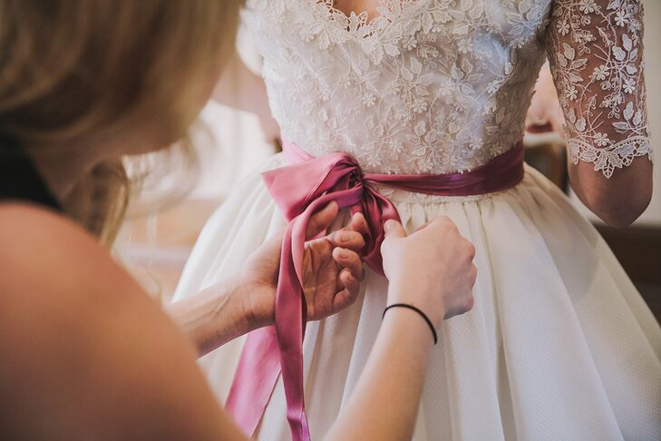 A sash is an easy way to add a personal (colorful) touch to a wedding gown.