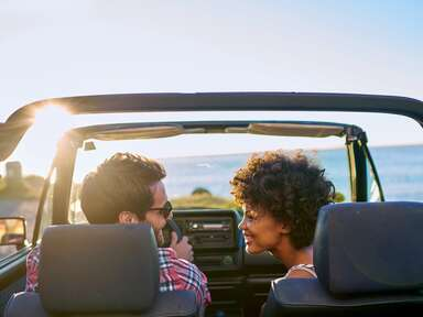 just married couple on road trip in convertible