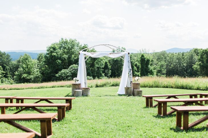 """Frederick happened across Longlook Farm in Sanbornton, NH on the website Home Away and was instantly drawn to its quaint country setting and intimate vibe. """"We were looking for a barn space where we could stay for an extended weekend with our families and also be able to bring our dog Maisy,"""" says Melissa. """"Longlook exceeded our expectations. It was such a gorgeous place."""" The couple made the most of the beautiful property, hosting the ceremony on the expansive lawn, cocktail hour in a tent outdoors and dinner and dancing in the rustic barn. """"There is also a stunning fire pit where we had s'mores and some fun late night conversations,"""" says Melissa."""