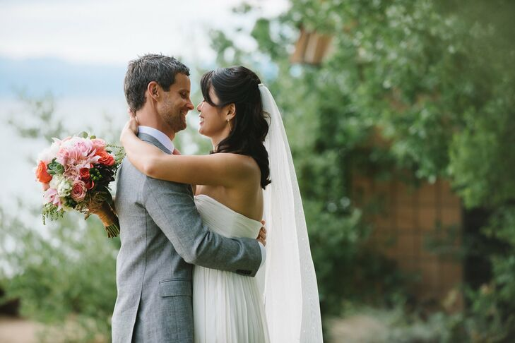 Stephanie wore her hair in a half up style with loose curls. For the ceremony she added a chapel length veil.