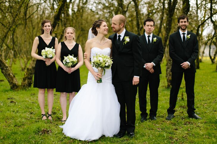 The bridesmaids wore short black jersey dresses, the perfect mix of comfort and style. The groomsmen wore classic black suits.
