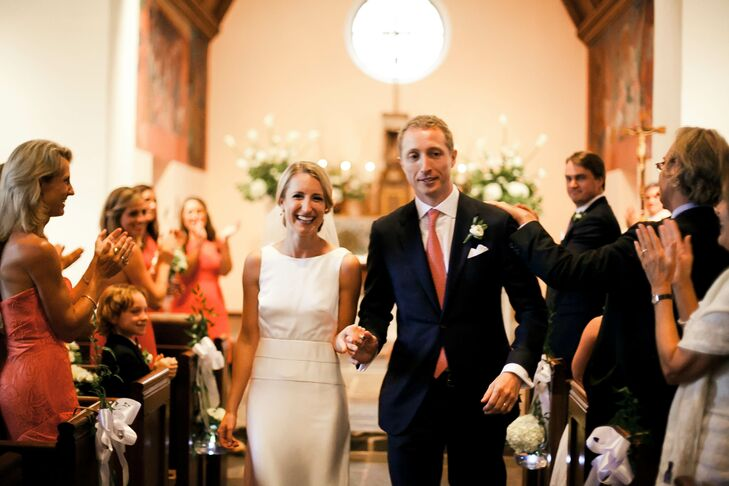 After a traditional ceremony filled with readings from their family members, Cam and Mike started their joyful recessional. Their love for white and green came out in every piece of decor. White hydrangeas tied to white bows and hanging clear glass votives highlighted each pew with a natural design.