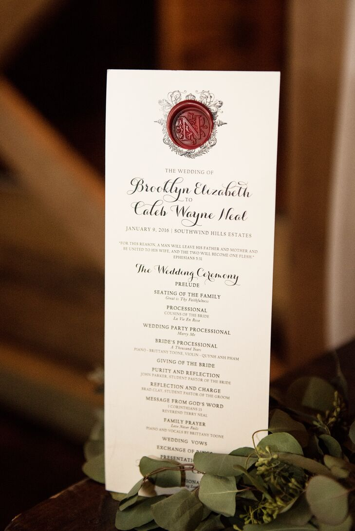 Each printed invitation was personally adorned with a bordeaux wax seal in the center of a crest and wrapped in bordeaux velvet ribbon. The programs for the ceremony were hand-stamped in exactly the same way.