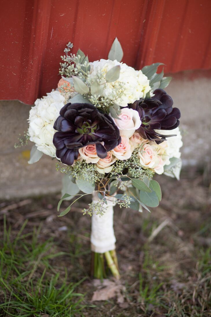 A Rustic Bridal Bouquet With Blush Roses White Hydrangeas And