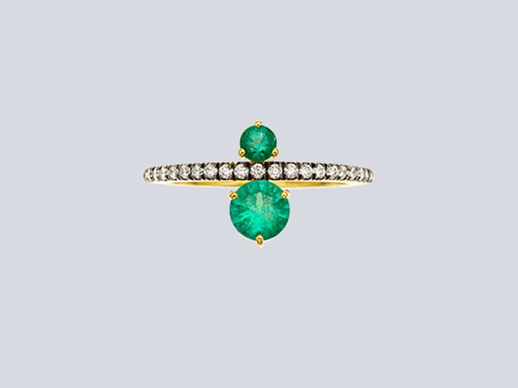 Double emerald engagement ring with pavé diamond band