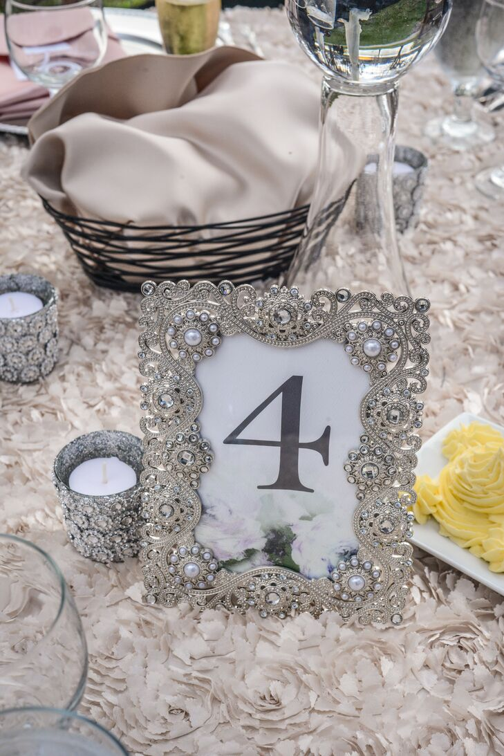 For an added vintage touch, the couple accented each  floral designed table number with an ornate silver frame.