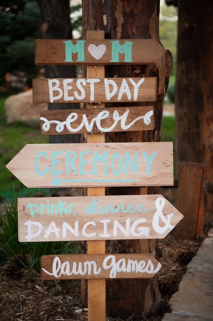 """In order to point guests in the right direction, Madeline and Matt created wooden arrows painted with the big events: ceremony, dinner and dancing. The top of the sign had their first initials with """"best day ever"""" written underneath."""