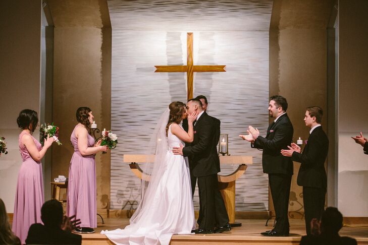 """Kelli and Adrian said their vows at Charity Lutheran Church, Kelli's family church. Reception was held at the Municipal Country Club, which the couple chose """"because it was timeless, humble and simplistic which is the way we aspire to spend the rest of our lives together.""""rn"""