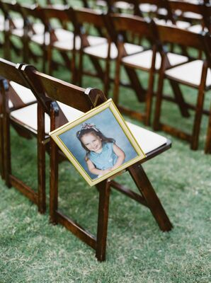 Aisle Décor Incorporating Photos of Bride and Groom as Children