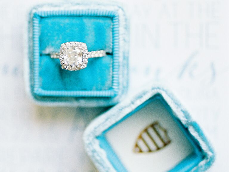 diamond engagement ring in a blue velvet ring box