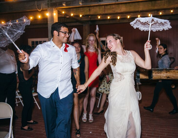 """""""There was a little bit of us in the entire wedding, but my favorite element was having a New Orleans-style Second Line at our reception,"""" says the bride. She and her friends hand-stamped the couple's initials on white handkerchiefs for guests to wave around during the Second Line and keep as a personalized wedding favor."""