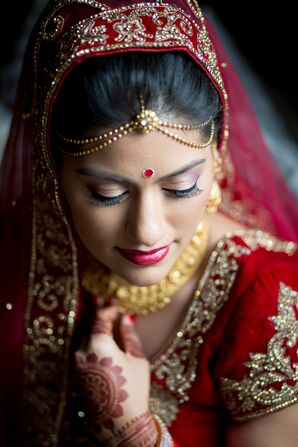 Indian Bride in Traditional Red and Gold Wedding Sari