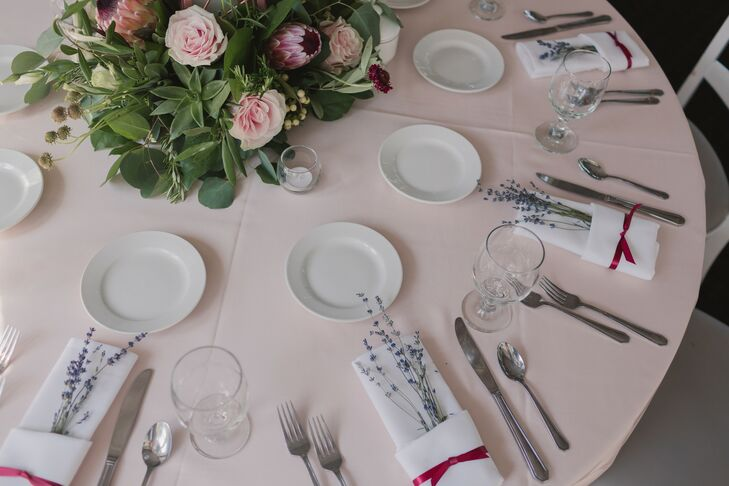 Pink and White Place Setting with Lavender Sprigs in Napkin