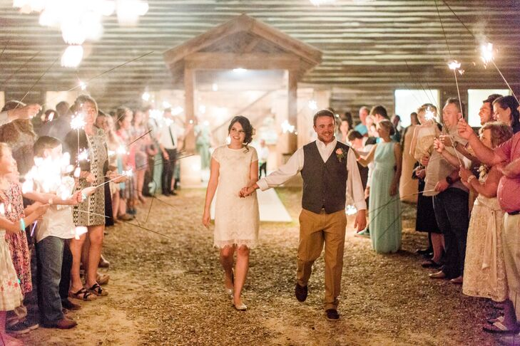 """We left the barn late into the evening with a sparkler tunnel guiding our way,"" Karley says of their romantic grand exit."