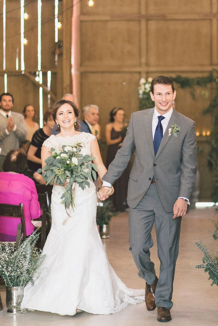 Jeffery had a boutonniere of greens pinned to his light gray jacket, which he wore with matching pants. He wore a navy blue tie to add a pop of color to the neutral-colored outfit. Melanie wore an ivory wedding dress entirely accented with a lace overlay.