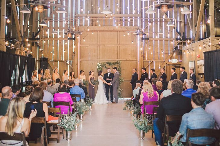 "The couple held their ceremony inside the rustic barn at Camarillo Ranch in Camarillo, California, with Edison bulbs twinkling above them and their guests. ""We loved our ceremony because it was handpicked by us,"" Melanie says. ""JJ's uncle was the pastor and my friends sang our communion song. It just felt like a complete reflection of our values."""