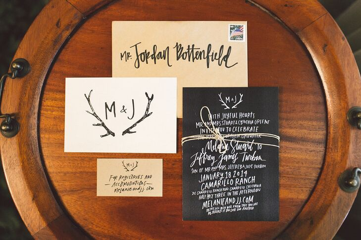 The wedding invitations were printed on black, white and yellow stationery, with calligraphy design by Melanie Stuart Designs and printed by Kindred. An antler design was printed on many of the pieces of stationery, reflecting the wedding's rustic style.