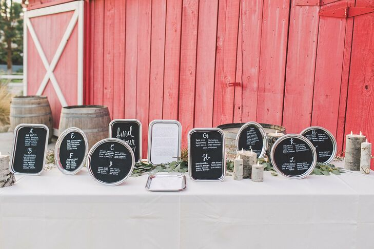 The seating assignments were displayed on small black chalkboards in different shapes bordered by a silver frame, which were located outside the rustic barn at Camarillo Ranch in Camarillo, California.