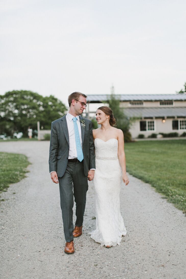 At 5-foot-1, Emily wanted to find a simple, elegant gown that wouldn't overwhelm her petite figure. On a trip to Allegria Bridal in Belmont, Massachusetts, she tried on a lace A-line gown from Amsale's Nouvelle line and was instantly smitten. For a hint of shimmer, she accentuated her waist with a crystal-embellished belt and added two crystal hair clips to her classic updo.