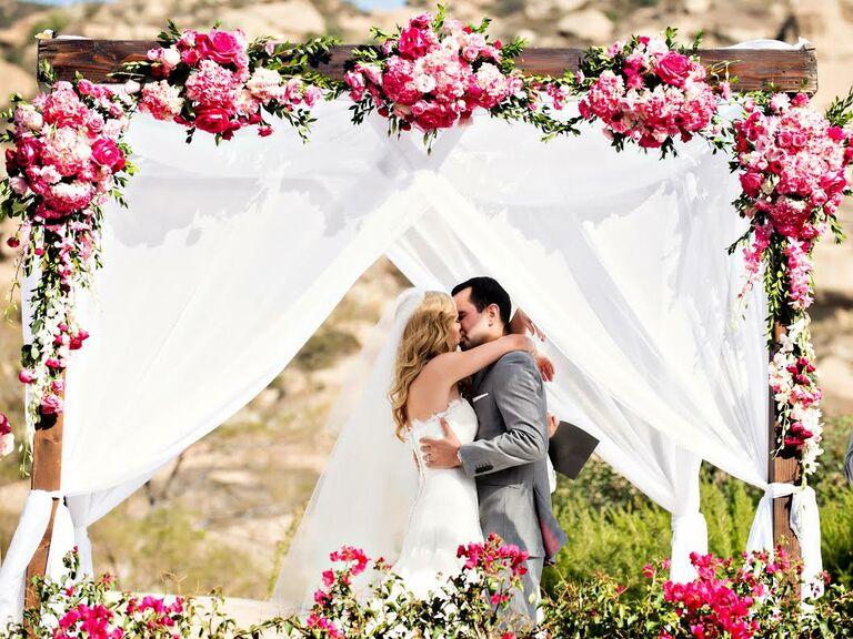 Couple kiss at wedding altar