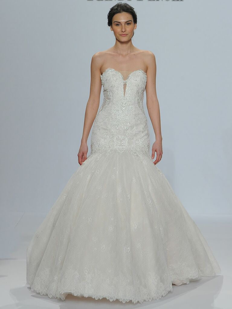 Randy Fenoli Spring 2018 strapless exaggerated mermaid wedding dress of Chantilly lace and beaded Venice lace appliqués with sheer side panels