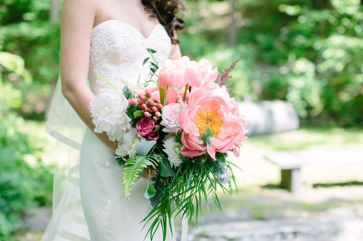 "Viridescent Floral Design dialed up the drama on Julia's down-the-aisle look with a textured, scene-stealing bouquet of oversize peonies, ferns, garden roses, ranunculus and more. ""Since my dress was simple, the bouquet was a great accessory,"" Julia says."