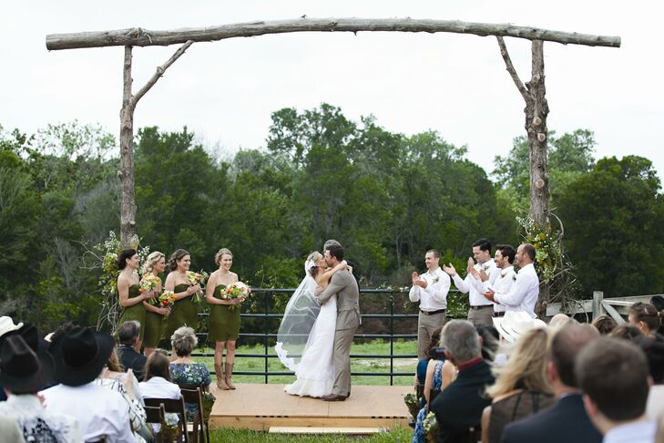 Together, the two families felled trees from the ranch, which Rebecca's father then crafted into the tall arch that framed the nuptials.