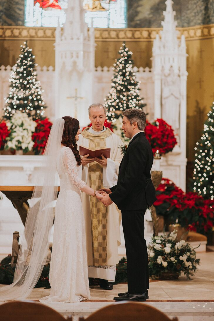 Cait and Tom said their vows at Lake Placid's St. Agnes Catholic Church, which was already partially decorated for Christmas—a benefit to the couple's décor budget.