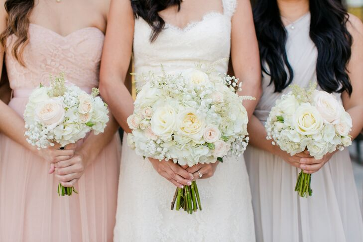 "Ivory hydrangeas, blush spray roses, white garden roses, white Estelle asters and baby's breath came together elegantly to from the bridal bouquet. ""I loved the ivory flowers for the Southern winter romantic wedding,"" Gladys says."