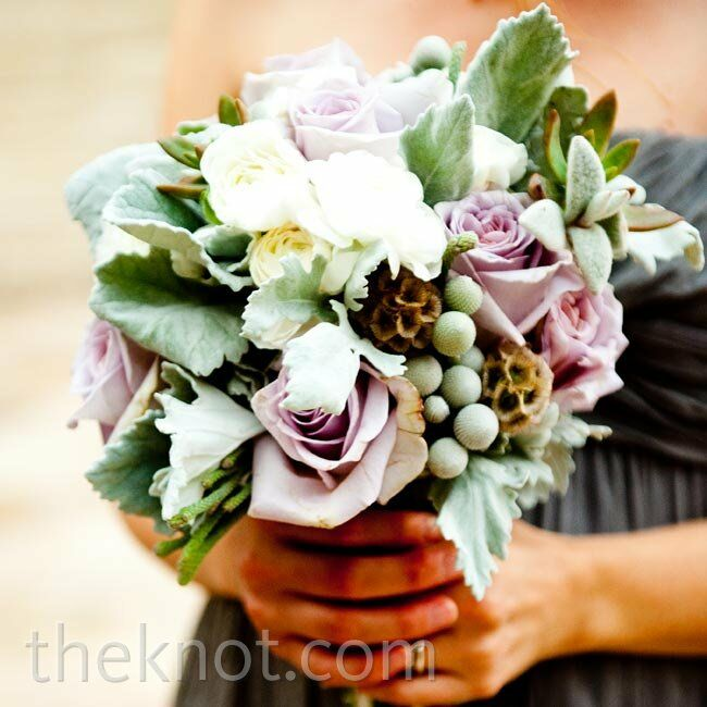 The bridesmaids carried smaller versions of Alexis's bouquet, minus the bold yellow accents.