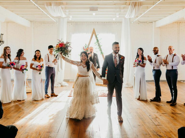 Bride and groom indoor wedding recessional