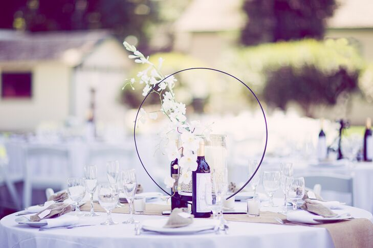 The bride and groom had six different styles of centerpieces. Some included silk  white orchids, silk white hydrangeas, and all had rustic pieces included.
