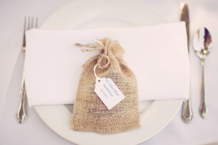 The bride and groom wanted to incorporate their love of coffee into their wedding. They gave each of their guests a small burlap bag full of their favorite coffee beans.