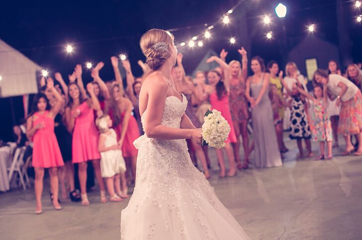 Bride Throwing Bouquet of White Roses
