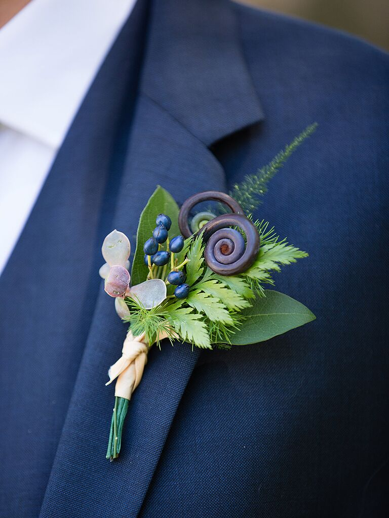 Unique boutoniere idea with berries and fiddlehead ferns