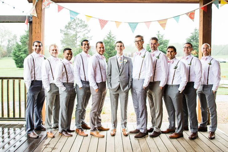 Jake's 10 groomsmen wore their own gray pants with white button-downs and brown shoes. Sophia and Jake's crafty friend hand-stitched all the pink-striped bow ties, and Jake gave each of them leather suspenders to complete the look. Since Jake wanted to stand out a little, he wore a three-piece light gray suit with a colorful striped tie.