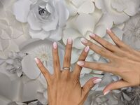 ombre wedding nails on top of flowers