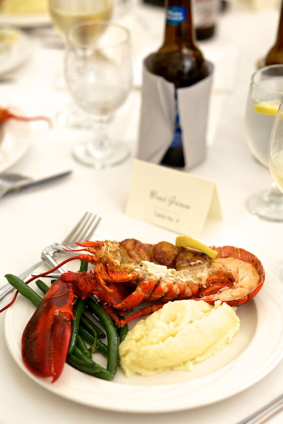 For dinner, guests dined on lobsters with scallops and a citrus herb butter, served with garlic mashed potatoes and haricots verts. They also had another meal choice of steak with seasoned potatoes.